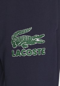 Lacoste - Spodnie treningowe - navy blue - 2
