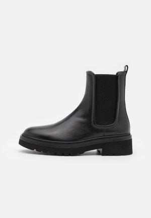 SIENA - Platform ankle boots - black
