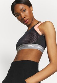ONLY Play - ONPMALIA SPORTS BRA - Medium support sports bra - neon orange/blue graphite - 5