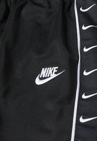 Nike Sportswear - TRICOT TAPING SET - Tepláková souprava - black - 4