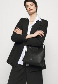 DKNY - CAROL POUCHETTE - Handbag - black/silver-coloured - 1