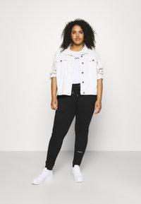 Calvin Klein Jeans Plus - PLUS MICRO BRANDING PANT - Tracksuit bottoms - black - 1