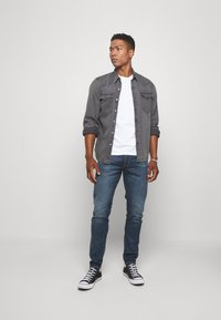 Levi's® - 512™ SLIM TAPER - Jeansy Slim Fit - blue denim - 1