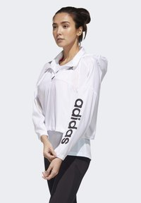adidas Performance - ACTIVATED TECH WINDBREAKER - Windbreaker - white - 4