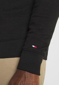 Tommy Hilfiger - CIRCLE CHEST CORP CREWNECK - Sweatshirt - black - 5