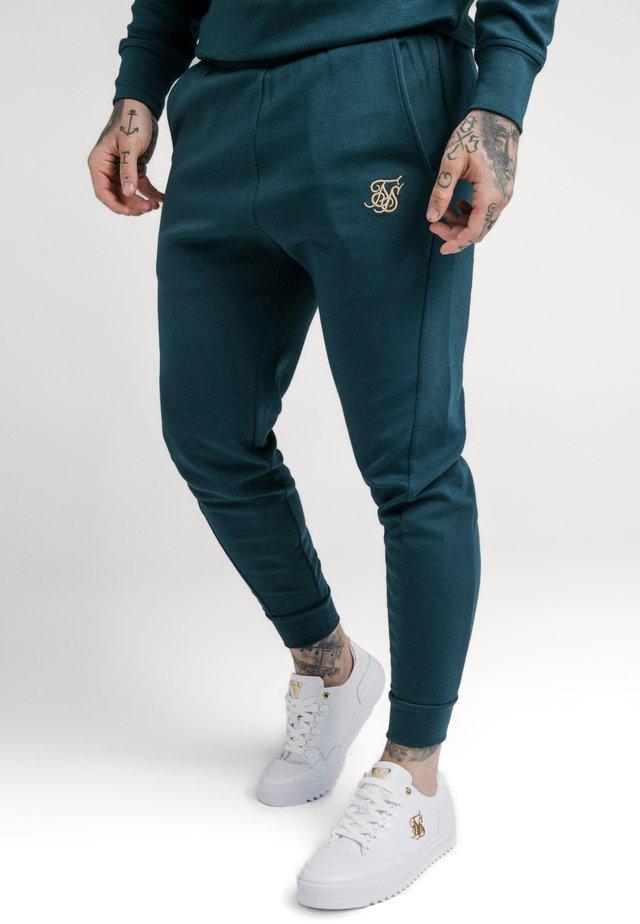 SIGNATURE TRACK PANTS - Pantalon de survêtement - ocean green