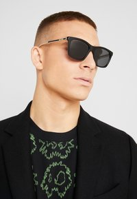 Gucci - Sunglasses - black/crystal/grey - 1