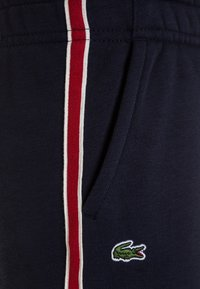 Lacoste - TROUSERS - Tracksuit bottoms - navy blue - 2