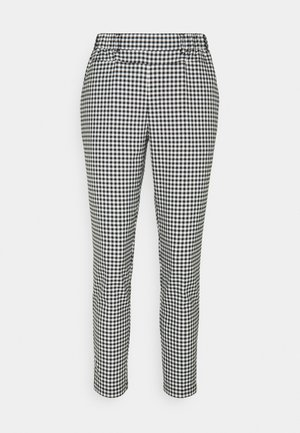 KATERNE 7/8 PANTS - Trousers - black/white