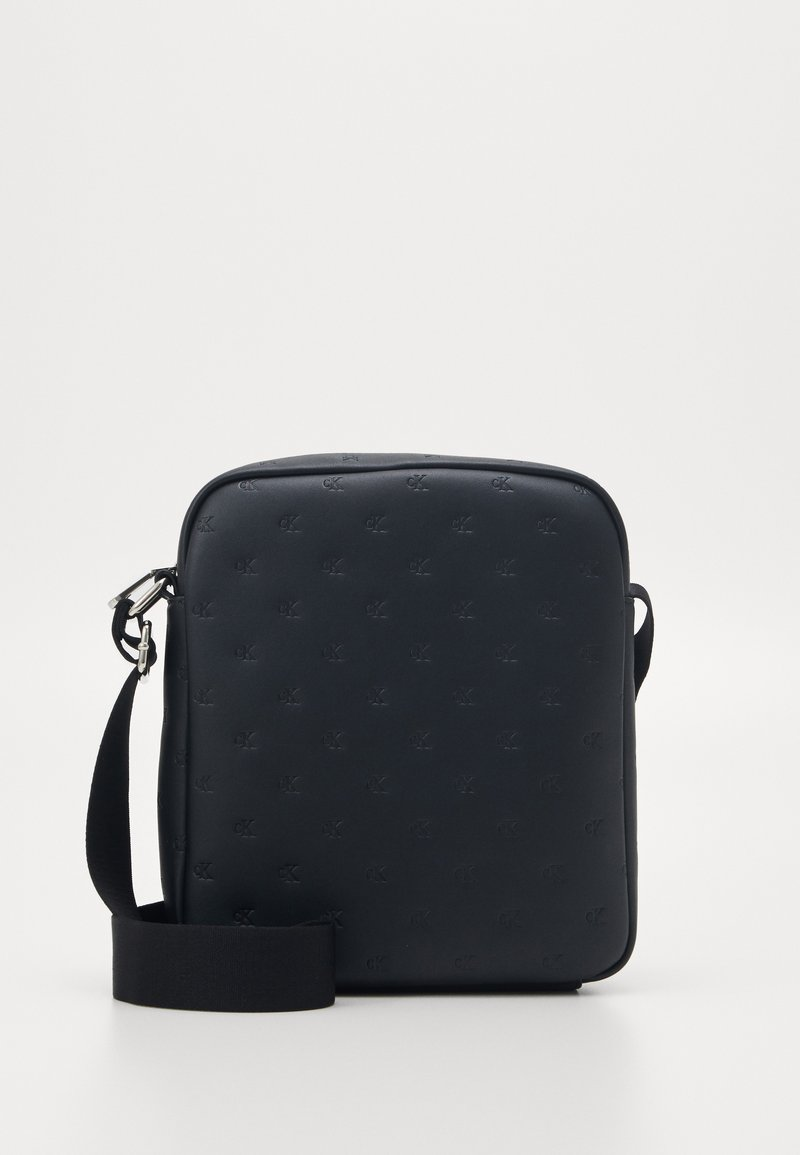 Calvin Klein Jeans - MONOGRAM EMBOSS FLATPACK - Across body bag - black