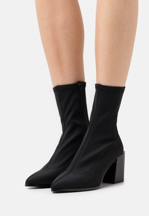 ADWIGOCIA - Classic ankle boots - black