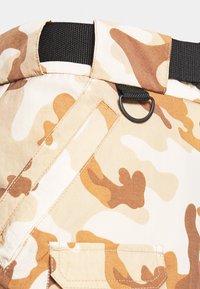 Karl Kani - SIGNATURE CAMO CRINCLE PANTS - Cargo trousers - beige/sand - 5