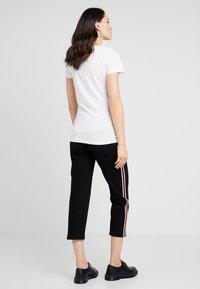 MAMALICIOUS - MLANNIA 2 PACK  - Basic T-shirt - black/snow white - 4