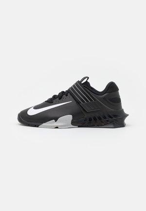 SAVALEOS UNISEX - Sports shoes - black/white/grey fog/laser orange