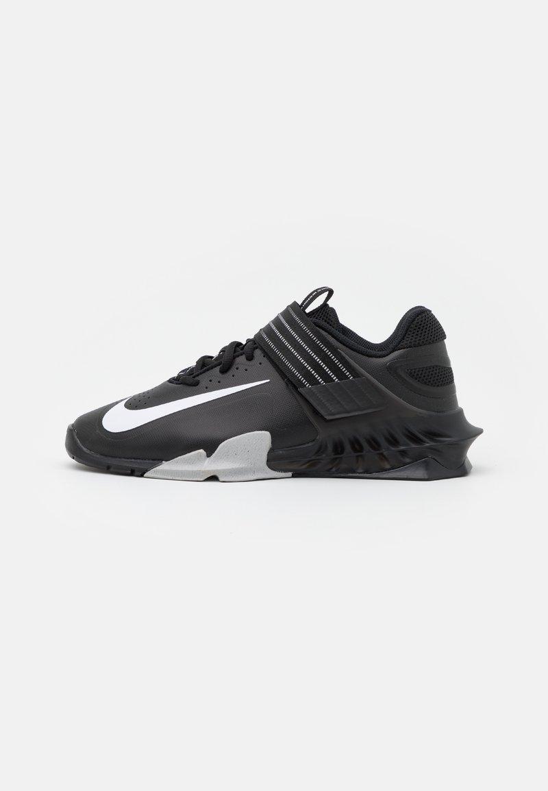 Nike Performance - SAVALEOS UNISEX - Sports shoes - black/white/grey fog/laser orange