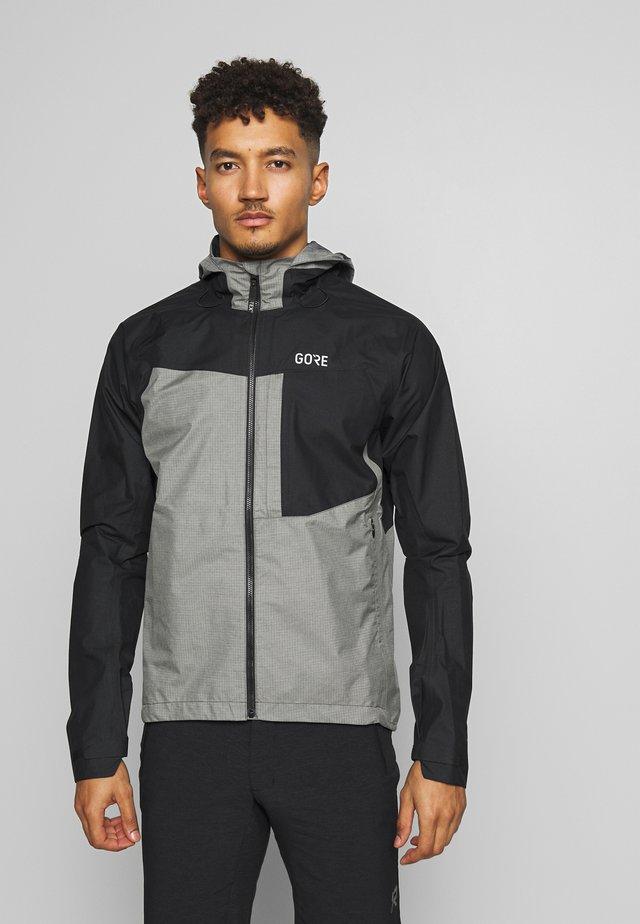 GORE® C5 GORE TEX TRAIL - Hardshell jacket - black