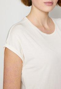 TOM TAILOR DENIM - Basic T-shirt - gardenia white - 6