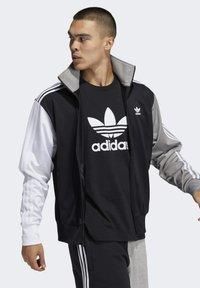 adidas Originals - BLOCKED FIREBIRD TRACK TOP - Training jacket - black - 0