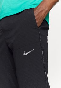 Nike Performance - RUN PANT - Træningsbukser - black/silver - 3