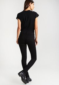 G-Star - LYNN MID SUPER SKINNY  - Jeans Skinny Fit - yield black ultimate stretch denim - 3