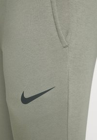 Nike Performance - PANT TAPER - Tracksuit bottoms - light army/black - 4
