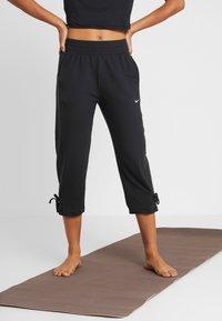 Nike Performance - YOGA PANT CROP - 3/4 sports trousers - black/white - 0