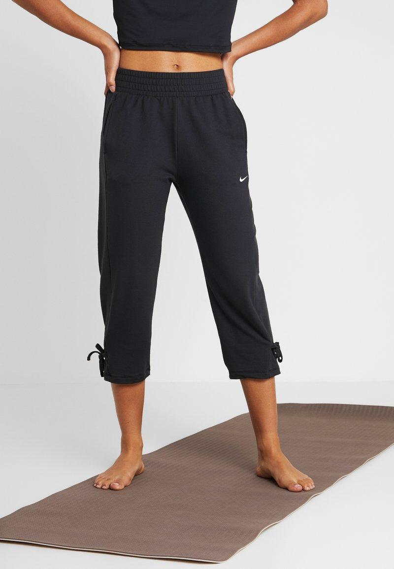 Nike Performance - YOGA PANT CROP - 3/4 sports trousers - black/white