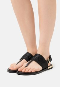 DKNY - AMBER SLINGBACK FLAT THONG - T-bar sandals - black/shiny black - 0