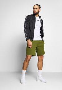 Jack & Jones Performance - JJIZPOLYESTER SHORT - Sports shorts - winter moss - 1
