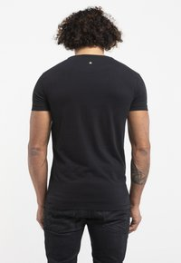 Liger - LIMITED TO 360 PIECES - Basic T-shirt - black - 2
