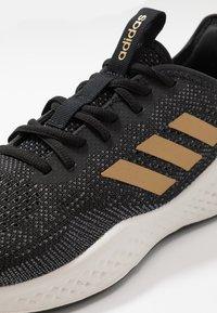 adidas Performance - FLUIDFLOW - Neutral running shoes - core black/tactile gold metallic/grey six - 5
