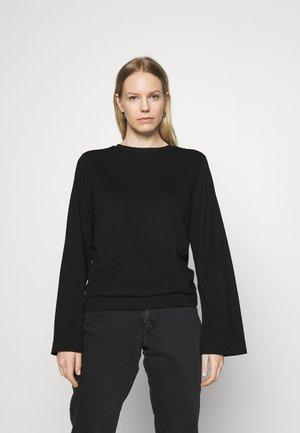CREW NECK ZIPPER AND ASYMETRICAL HEMLINE - Pitkähihainen paita - pure black