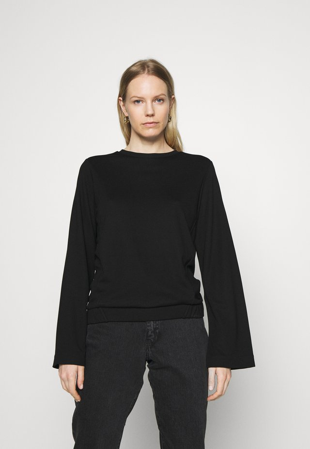 CREW NECK ZIPPER AND ASYMETRICAL HEMLINE - Top s dlouhým rukávem - pure black