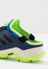 adidas Performance - TERREX HYDROTERRA - Hiking shoes - glow blue/core black/singnal green - 6