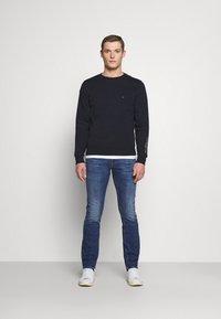 Tommy Hilfiger - SLIM BLEECKER ALGOOD  - Slim fit jeans - denim - 1