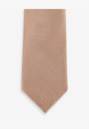 Tie - stone