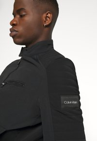 Calvin Klein - CASUAL NYLON BIKER BLOUSON - Summer jacket - black - 3