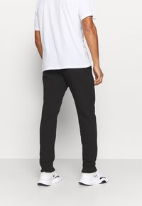 Champion - CUFF PANTS - Tracksuit bottoms - black - 2
