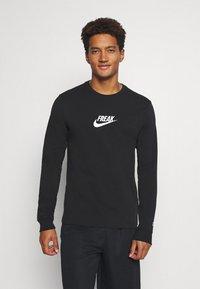 Nike Performance - TEE FREAK LONG SLEEVE - Long sleeved top - black - 0