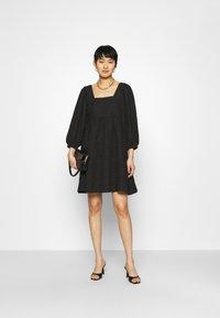 JUST FEMALE - TODA DRESS - Cocktail dress / Party dress - black - 1