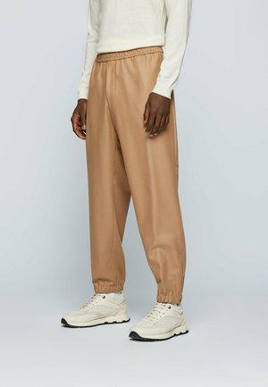 FILIPP - Tracksuit bottoms - beige