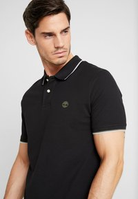 Timberland - TIPPED - Polo shirt - black - 3