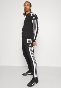 adidas Performance - SQUAD - Tracksuit bottoms - black - 3