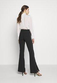 Victoria Victoria Beckham - SPLIT HEM TUXEDO TROUSER - Spodnie materiałowe - black - 2