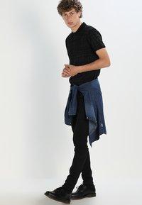 Lee - MALONE  - Jeans Skinny - black rinse - 1