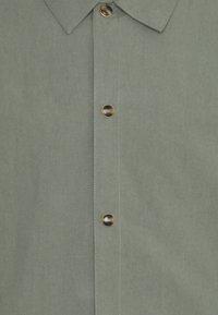 Han Kjøbenhavn - COACH JACKET - Summer jacket - army - 2