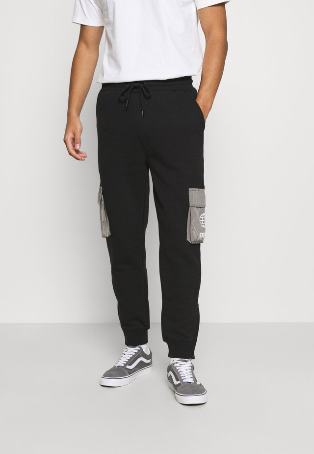 POCKET - Tracksuit bottoms - black