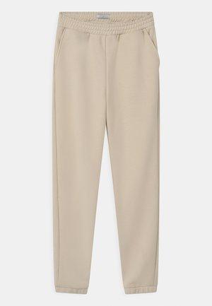 LILIAN - Teplákové kalhoty - cream white