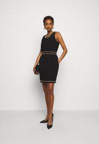 MOSCHINO - DRESS - Etui-jurk - black - 1