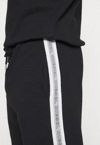 Diesel - UMLB-PETER TROUSERS - Pyjama bottoms - black - 4